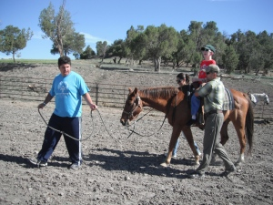 Special needs children interact with horses