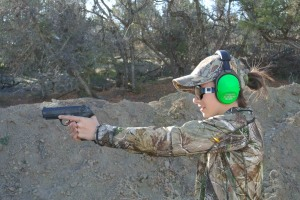 The Little Gal shooting a Beretta .40 cal. Wearing Altus Brands ReVO ProEars.
