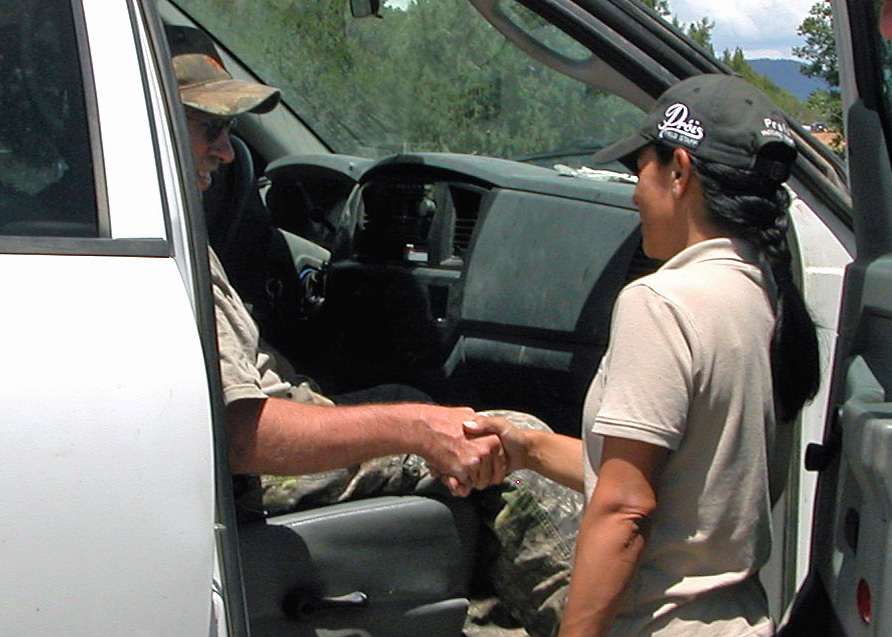 Mia Anstine meeting Outdoor Buddies WCO hunt recipient.